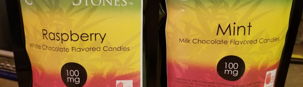 Canna Vita Botanicals Corner Stones Cannabis Infused flavored candies, two bags one of Raspberry White Chocolate flavor and one Mint Milk Chocolate flavor